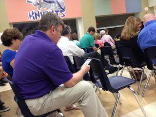 Man in purple shirt